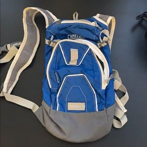 Mini blue camelback hydration pack
